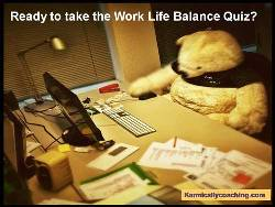 Teddy Bear taking work life balance quiz on computer